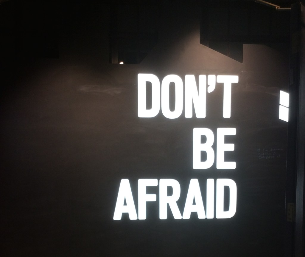 The words Don't Be Afraid, lit up at the end of the Seamus Heaney exhibition.