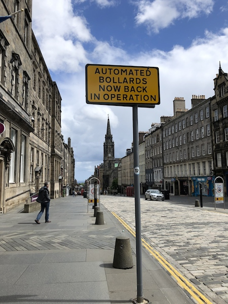 In lockdown, an empty Royal Mile: a street sign proclaims 'Automated Bollards Now Back in Operation': picture Fay Young