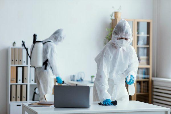people-disinfecting-biohazard-area