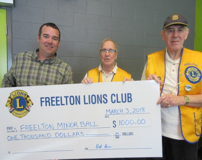 Freelton Lions present a cheque to Freelton Minor Ball Association