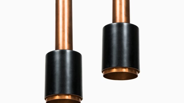 A pair of ceiling lamps in copper at Studio Schalling