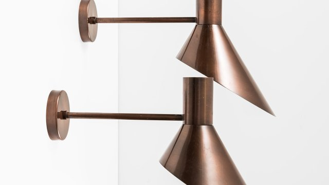 Pair of big wall lamps in copper at Studio Schalling