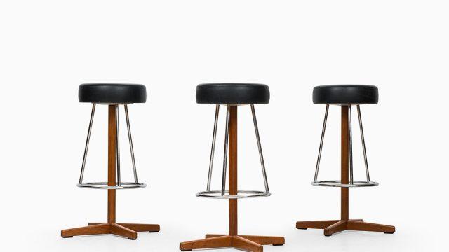 Bar stools in teak and chromed steel at Studio Schalling