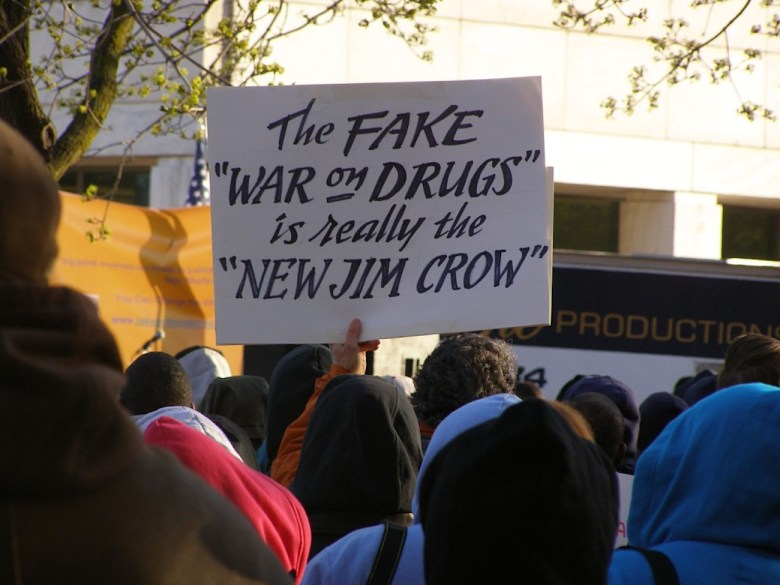 Protesters with anti-drug-war signs