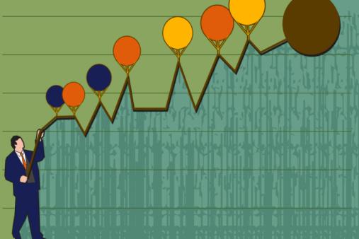 Businessman standing under a graph