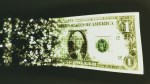 dissolving dollar bill