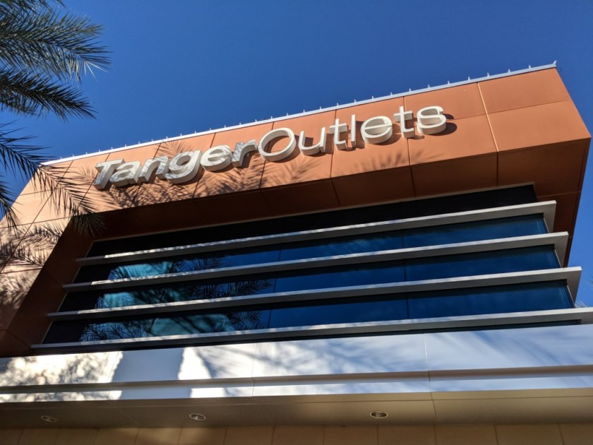 tanger outlets logo and store