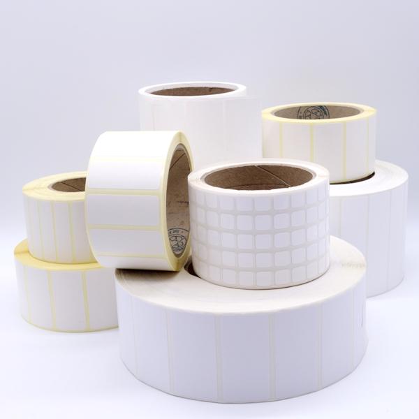 Weiße Spezialetiketten auf Rolle von Schlegel Etiketten