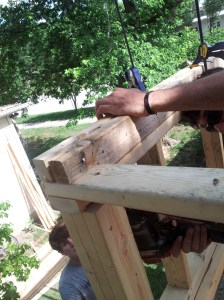 A header beam cut to fit around the framing.