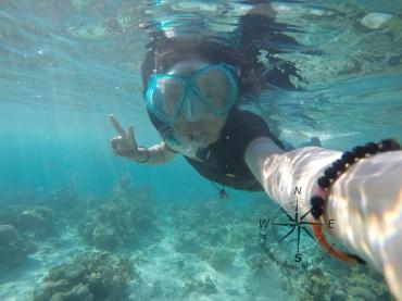 Enjoying Snorkeling around Sibuan Island, Semporna Island Hopping with a Peace Sign