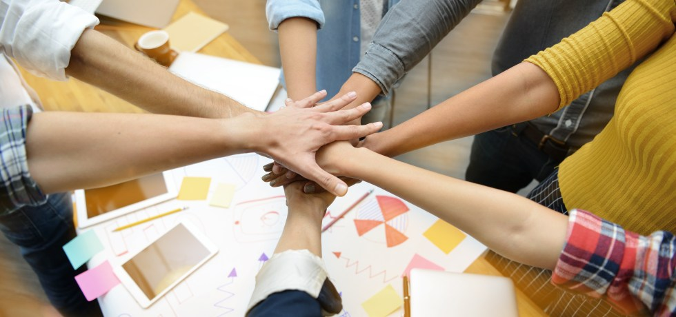 Hands of group of businesspersons showing teamwork