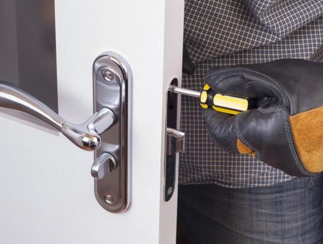 Schober Repair Services | Handyman Services Done Right - Handyman installing a door handle.