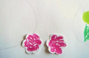 Die rosa Blüten stellen die Spalierobstbäume dar.