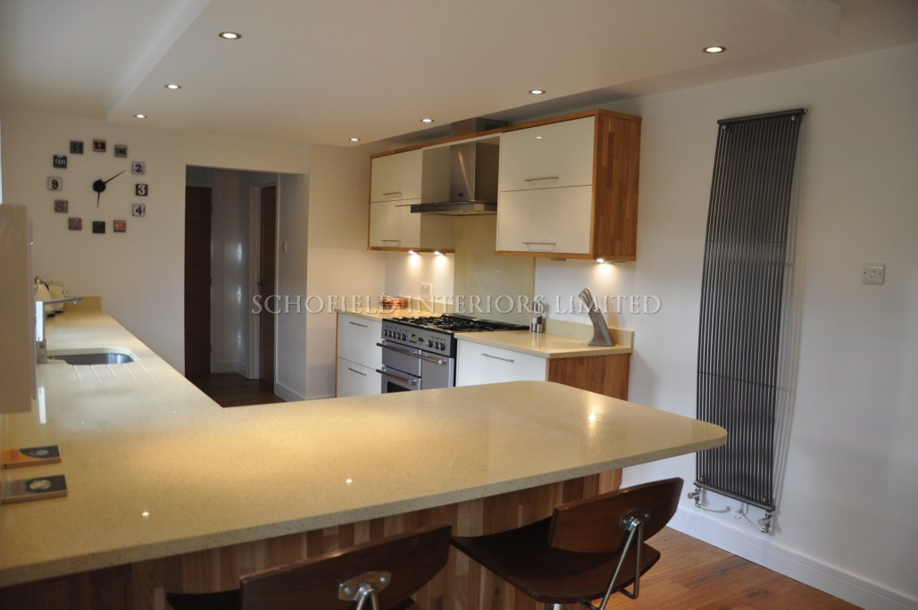 Odyssey Cream Gloss Kitchen with Solid Oak End Panels