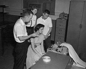 Students being introduced to an early computer