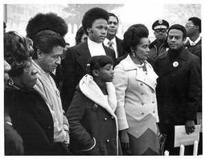Ron Sherman, Coretta Scott King, the King family, Maynard Jackson, U.S. Congressman Andrew Young, and Cesar Chavez at Martin Luther King, Jr.'s tomb, 1974.