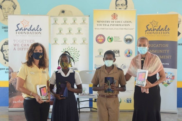 sandals foundation tablets hand over to ministry of education