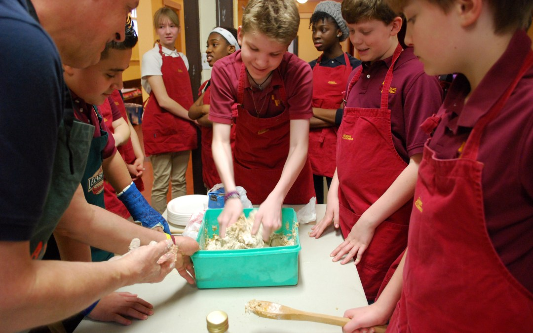 Middle School students making unleavened break on Maundy Thursday.
