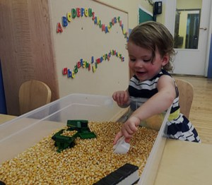 child playing in learning lab.