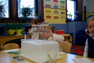 A preschool student experiencing science.