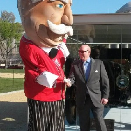 The National's Taft president mascot greets Taft biographer Michael Bromley in front of the first presidential automobile on display on the National Mall April 14-20, 2016.