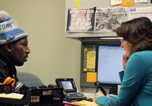 Jeremy Smallwood, who benefits from the Veteran's Resource Center, speaks with Pam Paxton- Keehner, the Veterans Services Coordinator. PHOTOS BY NATHAN GARTNER|PHOTO EDITOR