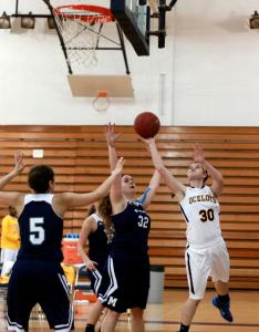 PHOTO BY MARGARET SHAW  STAFF PHOTOGRAPHER Sophomore guard Chelsey Wesley attempts a difficult shot from beneath the rim against Macomb. Wesley had five points, five rebounds and two blocks in the Ocelots 51-48 victory.