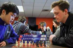 PHOTO BY ANDREW RELLINGER STAFF PHOTOGRAPHER Jeong-Ho Joo and chess club president Spencer Waldo concentrate on their game at a chess club meeting. The chess club provides a friendly, competitive environment for students at each meeting.