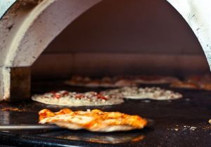 The stoves used on the premises are heated up to 800 degrees to provide rapid service when one orders a pizza.