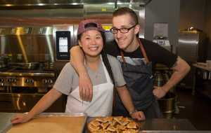 Former Schoolcraft culinary students Mei Lin and James Rigato pose for a photo during Savor Detroit on October 9, 2015.