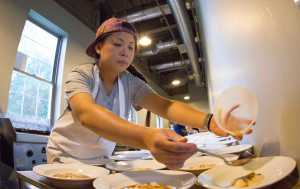 Top Chef winner Mei Lin prepares one of the featured meals.