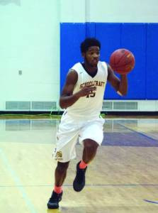 Freshman Guard Esa Abduljami (#15) rushes up court to get through to the basket at Schoolcraft College on Nov 11th.