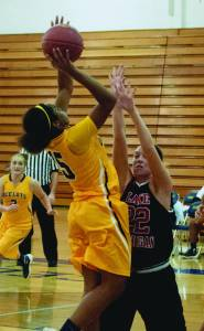Freshman Guard Jamyra Wilson (#15) looks for an open Lady Ocelot to pass the ball to for a scoring opportunity against Lake Michigan on Nov 11th at Schoolcraft College.