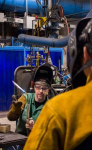 Welding Instructor Don Neilson shows the class what the flame coming from the torch means exactly and which gasses to balance for the flame to work properly.