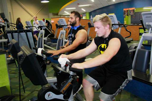 Students Max Wilkinson and Belal Kamil (right to left) bike to put in miles in the Expresso Fall Frenzy Challenge.