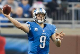 Matthew Stafford throwing a football during a game.