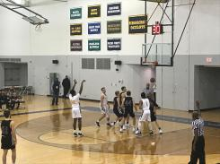 Ocelots and Lumberjacks are ready to fight for the ball, as Kemon Bassett, #12, makes his basket at a free-throw.