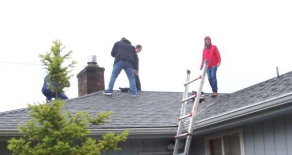 Field training, the class in checking out a roof in the rain