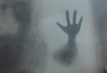 drawing of hand against window