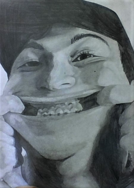 girl with braces making a face drawing