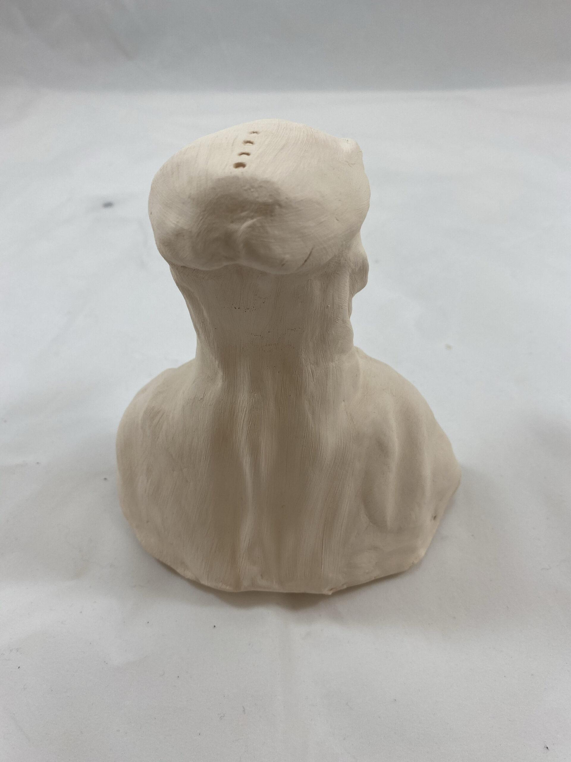 back of alien sculpture