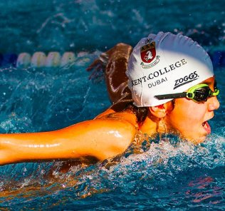 Photograph of a student engaged in competitive swimming at Kent College Dubai. The school offers specialist Sports scholarships which include bespoke mentoring programmes based on the gifts of the students.