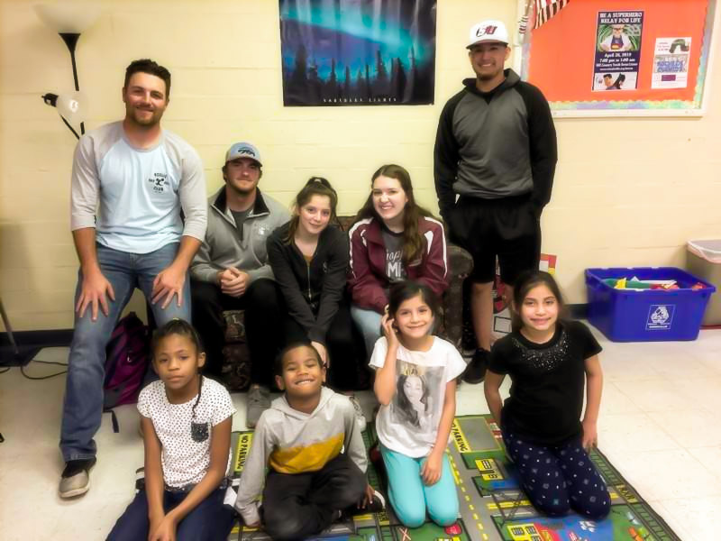 Schreiner students - Caleb Allen, Jordan Garcia and Jack Hakala - with youth from Doyle School Community Center