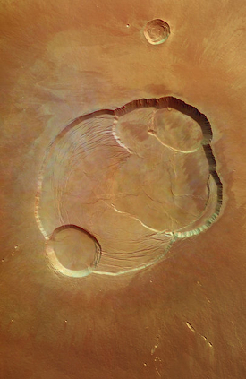 Detail of the complex caldera of Olympus Mons. This is the largest volcano in the solar system. There are signs that it might be dormant rather than extinct. Shows signs of activity in the geologically recent past and might erupt again. Credit: ESA/DLR/FU Berlin (G. Neukum)