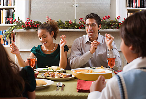 getty_rf_photo_of_family_singing_songs_at_dinner