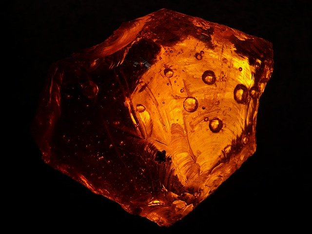 Amber fossil with air bubbles.