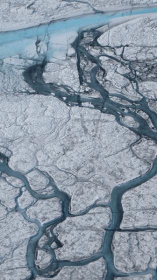 Greenland river July 2012 By M. Tedesco/CCNY for NASA ICE [Public domain], via Wikimedia Commons