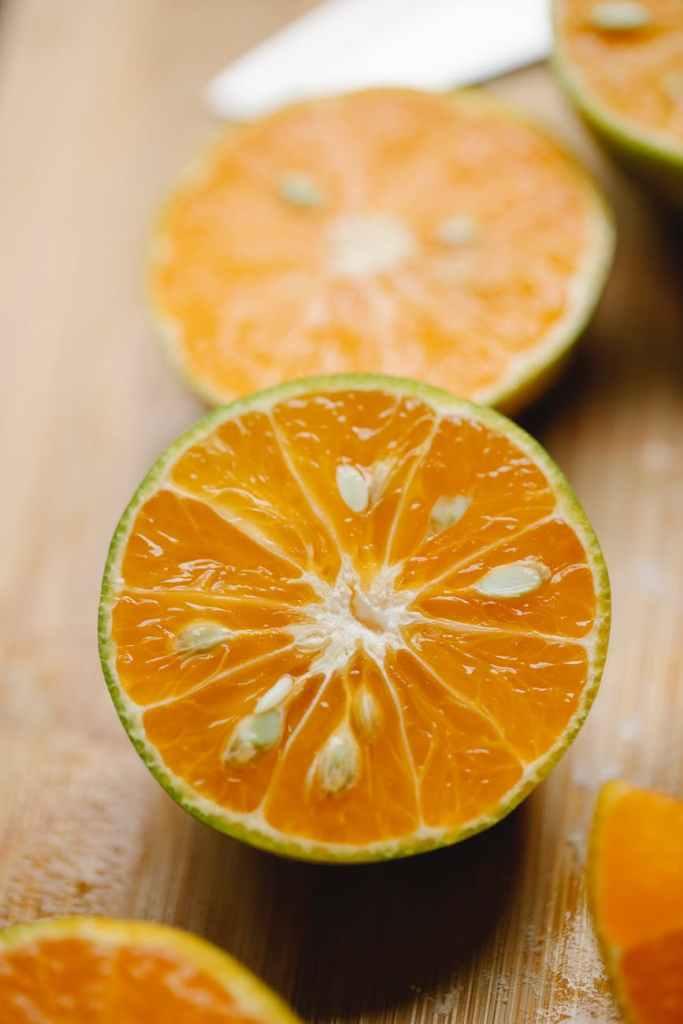 sliced fresh citrus on wooden cutting board