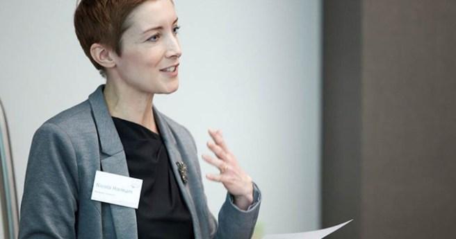Communicator scientist delivering a speech