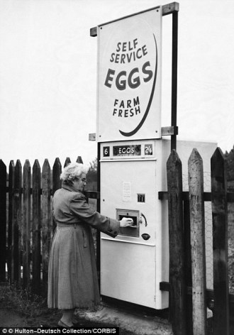 24e901c900000578-2923545-1960_derbyshire_england_uk_a_woman_collects_pre_packed_eggs_from-a-157_1422027472509